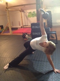 Lori using kettlebells
